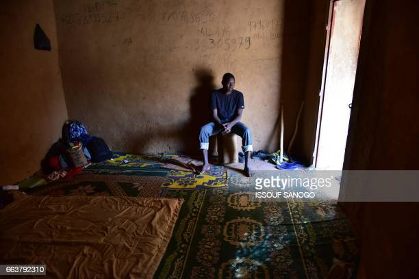Migrants from West Africa wait at a 'ghetto' in Agadez northern Niger on April 1 to go to Libya from where they will attempt to reach Europe by...