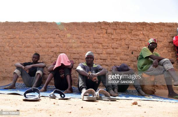Migrants from West Africa wait in a room at a 'ghetto' in Agadez northern Niger on April 1 as they wait to go to Libya from where they will attempt...