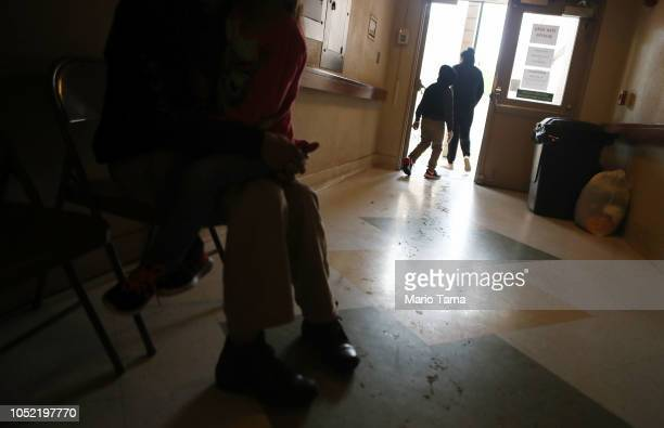Migrants gather at an Annunciation House shelter for migrants on October 12 2018 in El Paso Texas Annuciation House said it is currently receiving...