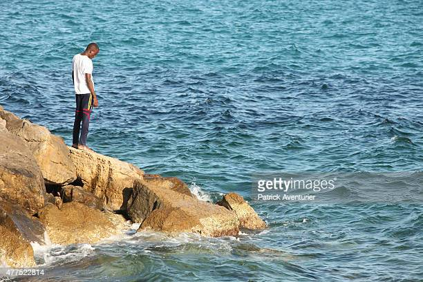 Migrants gather at the French border hoping to enter the country on June 17 2015 in Ventimiglia Italy A group of around 200 migrants mostly from...