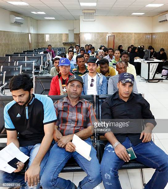 Migrants gather at the Search and Follow Up Department in the Qatari capital Doha on November 8, 2016 Officials are wary as Qatar has faced constant...