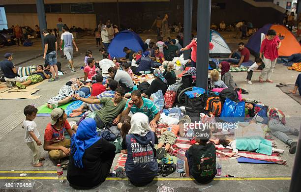 Migrants gather in the transit zone at Keleti station in central Budapest on September 1 2015 in Budapest Hungary The station was closed today and...