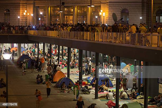Migrants gather in the transit zone below Keleti station in central Budapest on September 1 2015 in Budapest Hungary The station was closed today and...