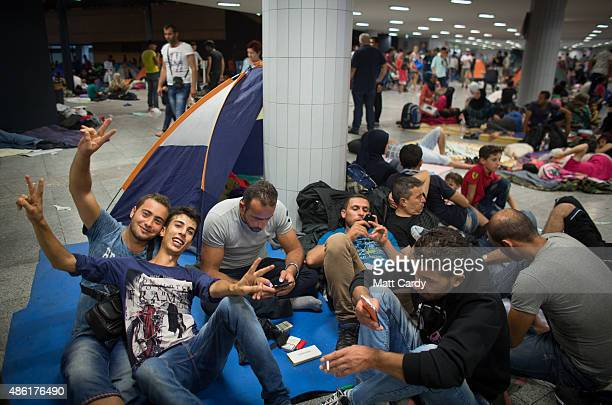 Migrants gather in the transit zone near Keleti station in central Budapest on September 1 2015 in Budapest Hungary The station was closed today and...