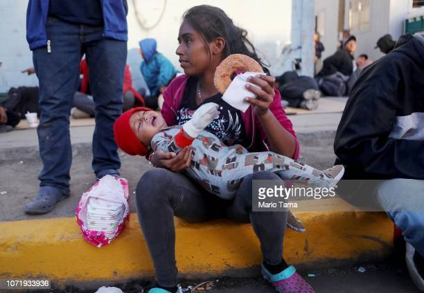 Migrants gather outside a temporary shelter set up for members of the 'migrant caravan' on November 24 2018 in Tijuana Mexico Around 6000 migrants...