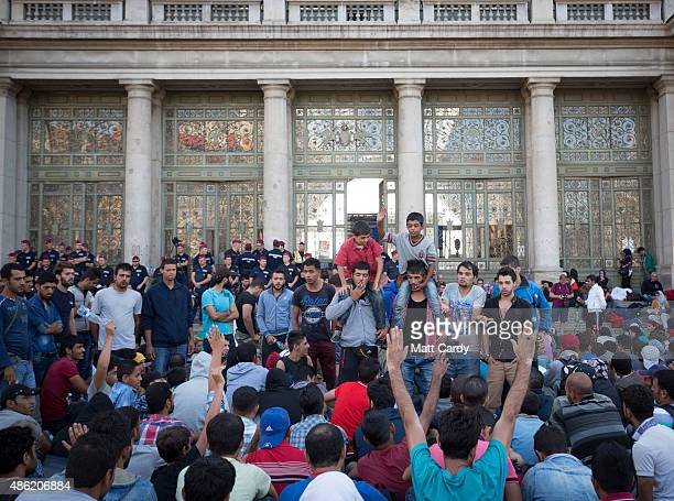 Migrants gather outside Keleti station which remains closed to them in central Budapest on September 2 2015 in Budapest Hungary The station was...
