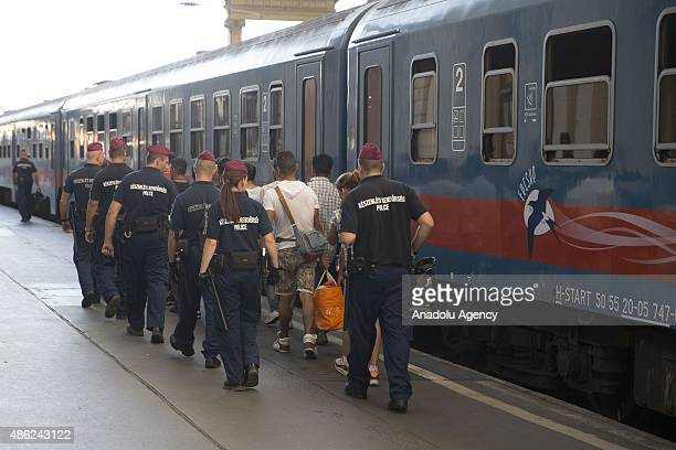 Migrants get on the train at Keleti station which remains closed to them in central Budapest on September 2 2015 in Budapest Hungary Hundreds of...