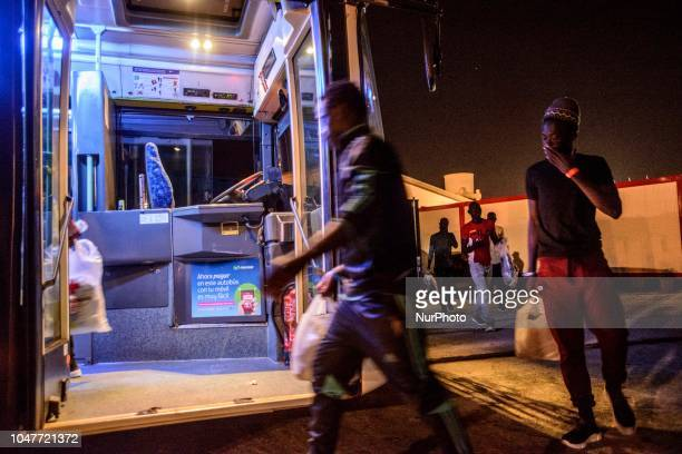 Migrants getting onto the bus to be transferred to a center on October 6 Malaga