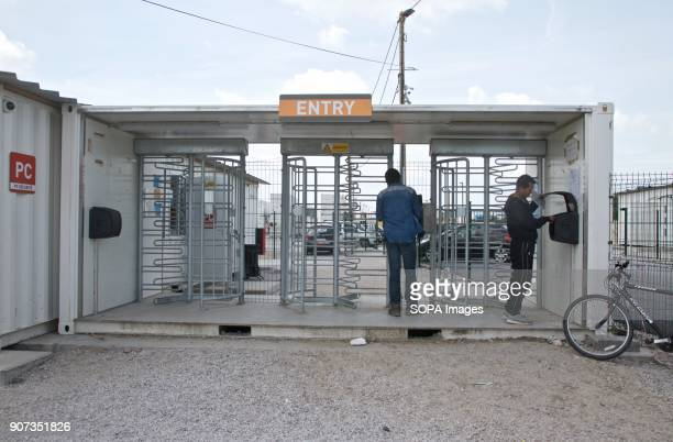 Migrants go through security in the camp in Calais where thousands were living in the hopes of getting to the UK before it was demolished The Calais...