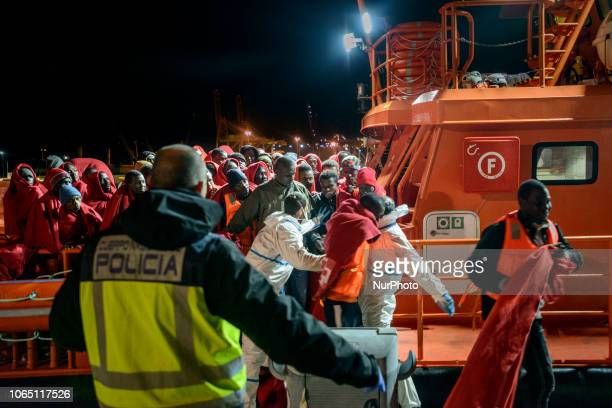Migrants going towards the Red cross tent to be attended by the Red cross team Malaga The Spaniard Maritime vessel rescued in the Mediterranean sea...