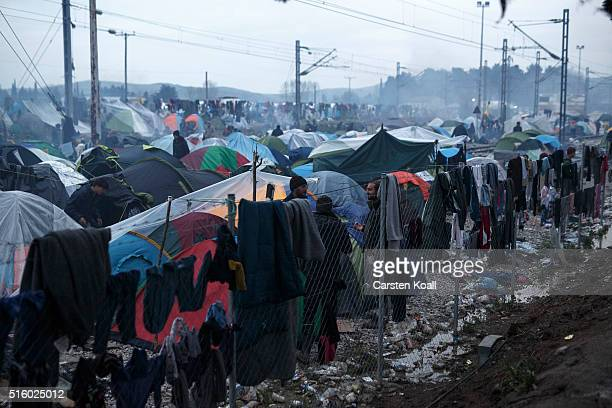 Migrants have hung on a fence washed laundry out to dry at the Idomeni refugee camp on March 16 2016 in Idomeni Greece The decision by Macedonia to...