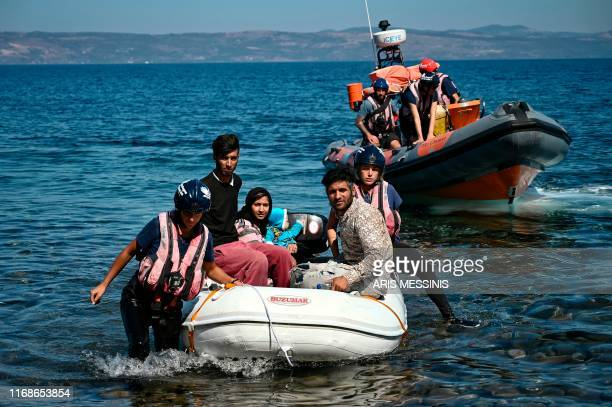 Migrants helped by rescuers arrive on the Greek island of Lesbos after crossing the Aegean Sea from Turkey, on September 16, 2019. - Migration is a...