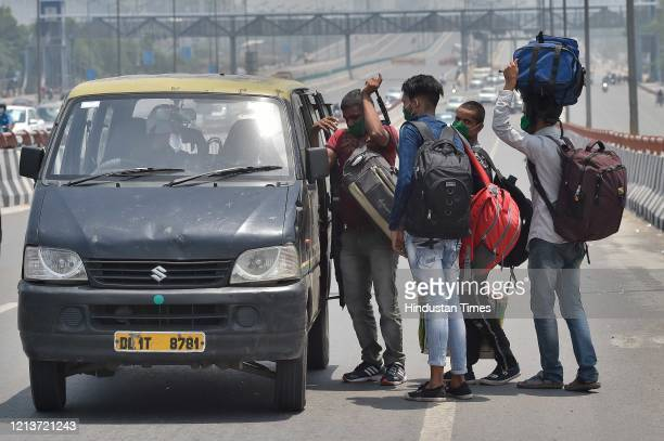 Migrants hitching a ride along Meerut Expresway while journeying to their homes in Uttar Pradesh during lockdown on May 18 2020 in New Delhi India