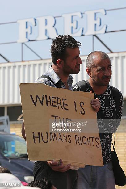 Migrants hold a sign that says 'where is the human rights' as they take part in a small protest after the previous day's friction at the border...