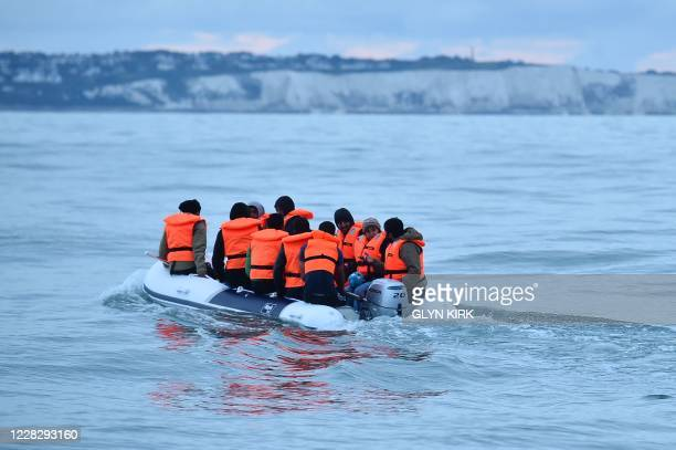Migrants in a dinghy sail in the Channel toward the south coast of England on September 1, 2020 after crossing from France. - Migrant crossings of...