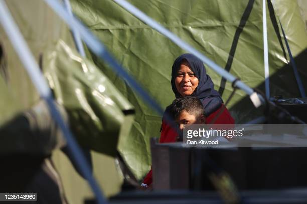 Migrants in a temporary facility in Dover docks on September 9, 2021 in Dover, England. Facing a continued rise in migrant arrivals across the...