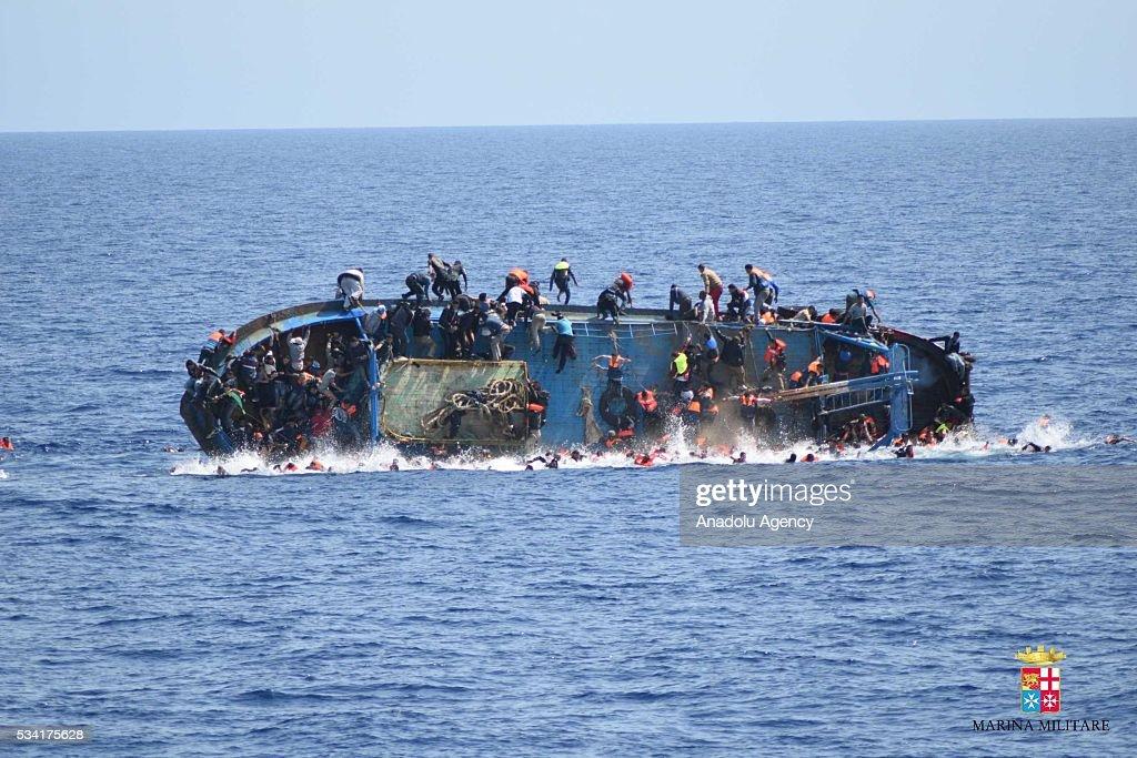 500 migrants saved by Italian Navy in Mediterranean sea : News Photo