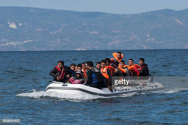 migrants in inflatable boat between greece and turkey - mediterranean sea stock pictures, royalty-free photos & images