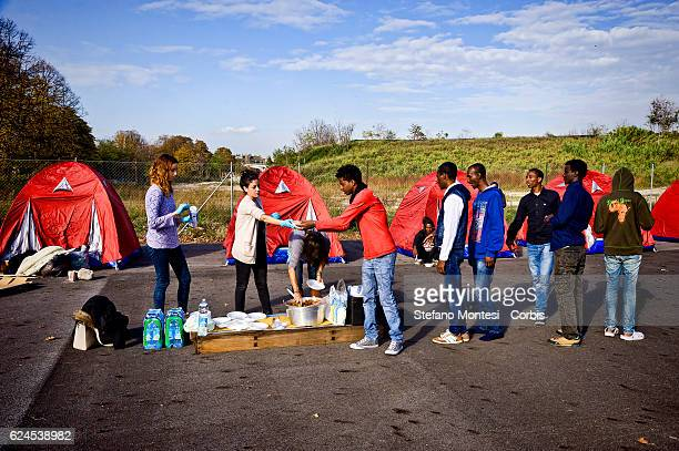 Migrants in line for lunch at the tent city for migrants in transit , by the volunteers of Baobab Experience and Doctors for Human Rights close to...