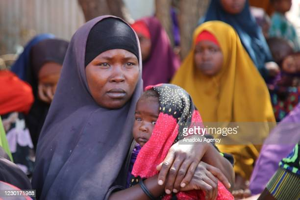 """Migrants in the slums of the capital Mogadishu are seen trying to survive in makeshift tents on December 13, 2020 in Mogadishu, Somali. The """"December..."""