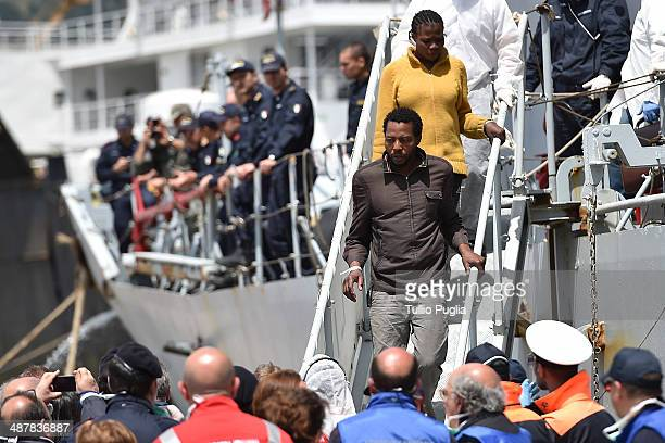 Migrants including a pregnant woman disembark from Italian Navy Ship Libra docked in the Port of Palermo and carrying 358 migrants rescued between...