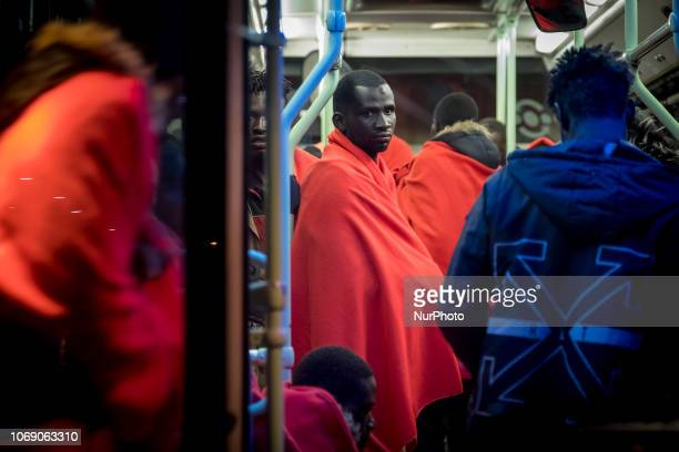 Migrants inside a bus witing to be transferred to the Red Cross Care unit Malaga