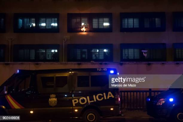 Migrants inside Aluche CIE burning papers in the windows as a demonstration arrives to demand the closure of detention centers after the last dead...