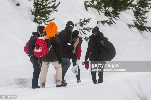 Migrants joke after crossing the French border on December 22 2017 in Bardonecchia Turin Italy After the police reinforced the Frejus and and...