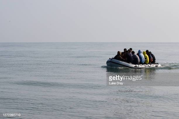 Migrants land on Deal beach after crossing the English channel from France in a dinghy on September 14, 2020 in Deal, England. More than 1,468...