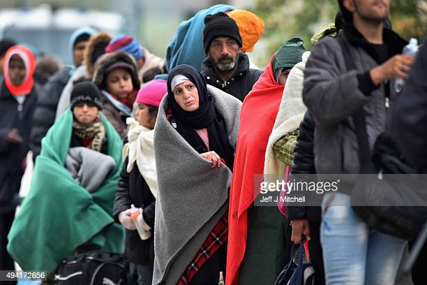 Migrants leave Brezice refugee camp to board buses as they continue they journey north towards Austria on October 25 2015 in Brezice Slovenia...