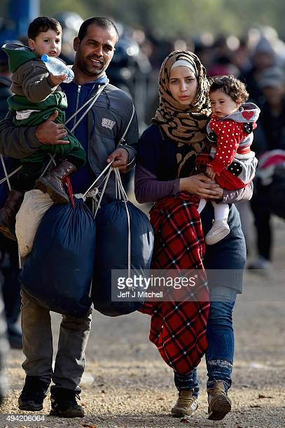 Migrants leave Brezice refugee camp to board buses as they continue they journey north towards Austria on October 25 2015 in BreziceSlovenia...