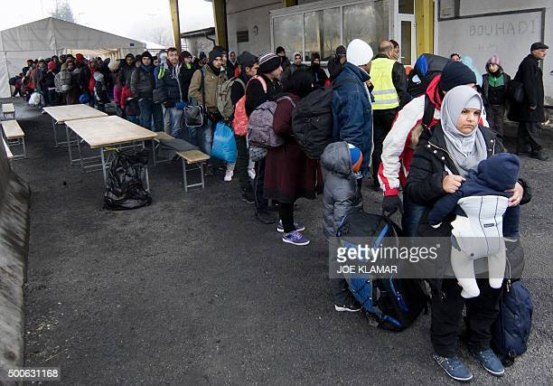 Migrants line up at transit area between Austria and Slovenia at border crossing in Spielfeld Austria on December 9 2015 Austria has begun to build a...
