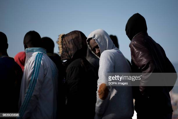 PORT MOTRIL GRANADA SPAIN Migrants lining up before be assisted by Red Cross after their arrival at Motril port 96 migrants were rescued by Spanish...