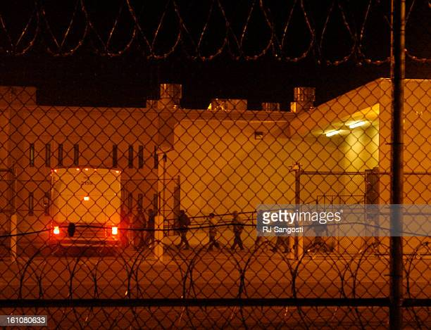 DEC 12 2006 Migrants load onto a bus early in the morning Tuesday Dec 12 at the Val Verde Correctional Facility in Del Rio Texas The migrant inmates...