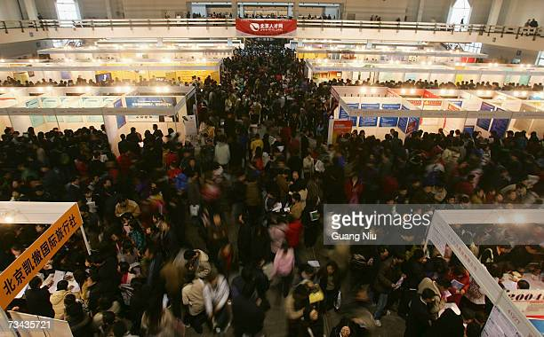 Migrants look for jobs at a job fair on February 27 in Beijing China A large number of migrants visited the job fair in search of work after spending...