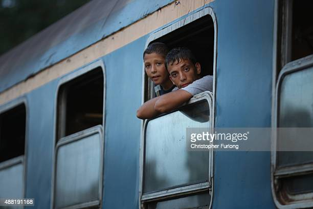 Migrants look on packed on a train at Roszke train station destined for the Austrian border after the hungarian authorities closed the open railway...