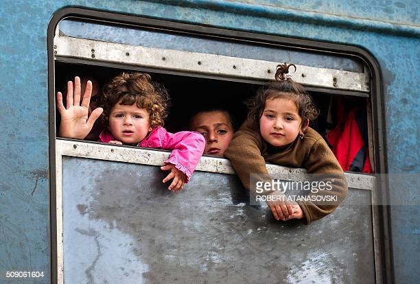 Migrants look out of the window from a train heading to Serbia at the border between Greece and Macedonia near the town of Gevgelija on February 8...