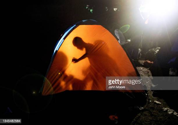 Migrants, most from Haiti, spend a night at a base camp before trekking through the infamous Darien Gap on their journey towards the United States on...