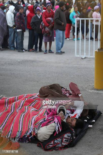 Migrants most of whom are part of a recently arrived caravan are seen at a migrant hostel as they wait to apply for asylum in to the United States on...