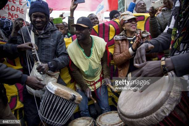 Migrants mostly coming from Nigeria Senegal Pakistan and Bangladesh play music as they gather to attend a march in the streets of the city during the...