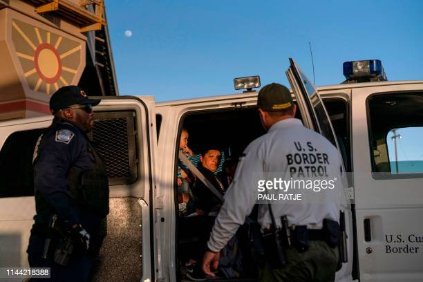 Migrants mostly from Central America board a van which will take them to a processing center on May 16 in El Paso Texas About 1100 migrants from...