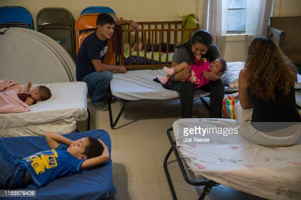 Migrants mostly from Honduras Guatemala and Brazil prepare to sleep on cots setup at the El Calvario Methodist Church which is housing migrants who...