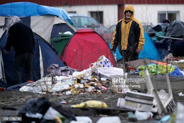 Migrants move their belongings as French police clear a migrant camp near Calais Port on January 08, 2019 in Calais, France. In recent weeks there...