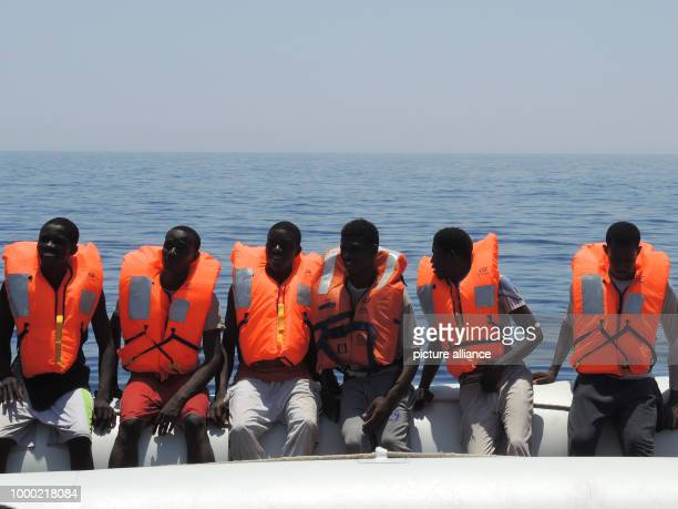 Migrants on a flimsy rubber boat wait for the rescue ship 'Aquarius' in the Mediterranean Sea 27 June 2017 The humanitarian aid organisation Doctors...