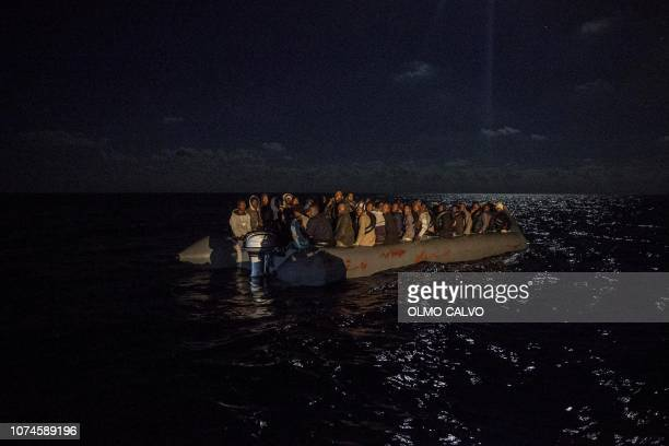 Migrants onboard an inflatible boat wait for being rescued off the coast of Libya on December 21 2018 by Proactiva Open Arms organisation Italy on...