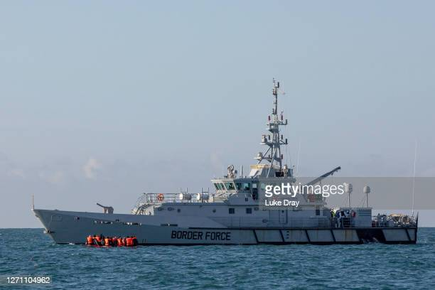 Migrants packed tightly onto a small inflatable boat are intercepted by the UK border force as they attempted to cross the English Channel near the...