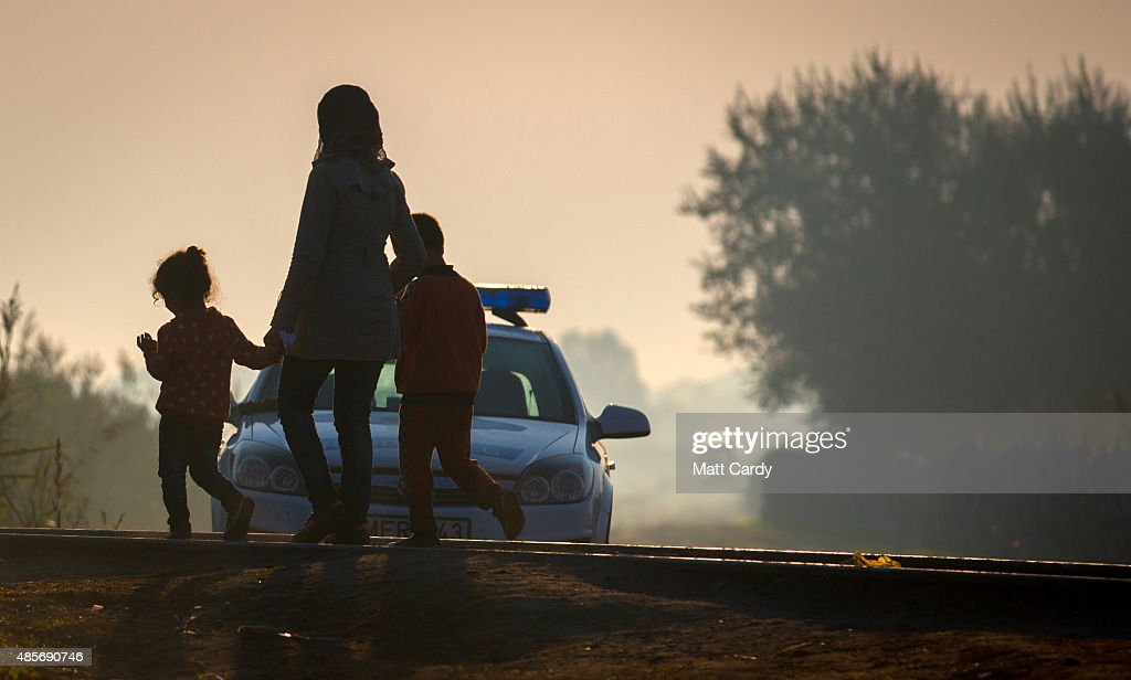In Focus: Migrants Journey as The Sun Goes Down Photos and Images ...