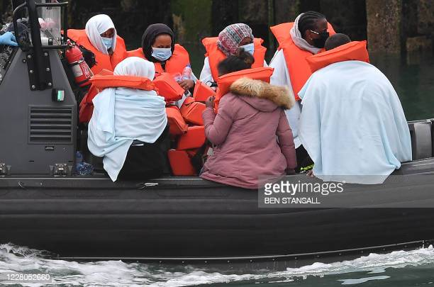 Migrants picked up at sea whilst Crossing the English Channel, but intercepted but intercepted bu UK Border Force officials, travel in a RIB with as...