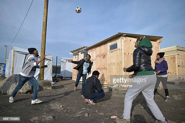 Migrants play hand ball in the camp known as the 'New Jungle' on December 3 2015 in Calais France Thousands of migrants continue to live in the...