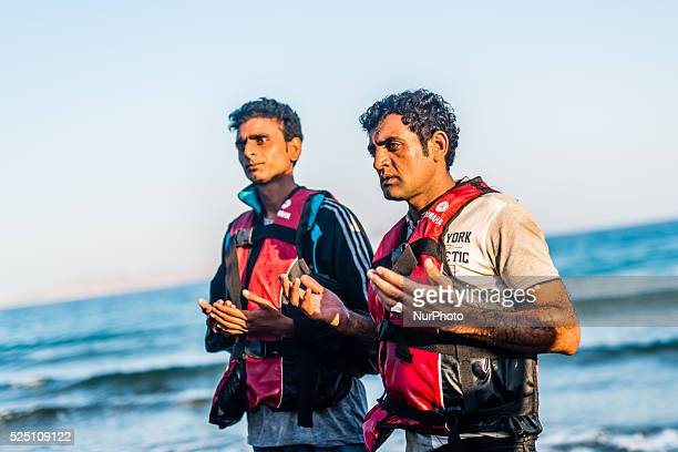 Migrants pray as they arrived in Kos Island on August 30 2015 The EU is grappling with an unprecedented influx of people fleeing war repression and...